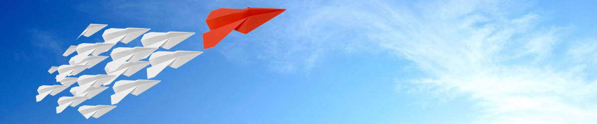 Group of paper airplanes in a blue sky, following one large red paper airplane